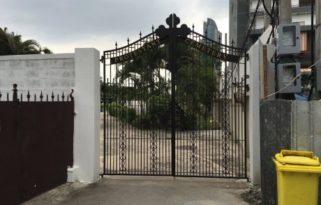 The gate to the cemetery, which is open everyday.
