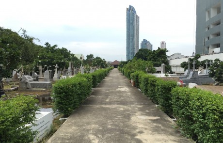 The view of the cemetery looking toward the river. The tall building in the background is the Watermark Condo, and is on the far side of the river.